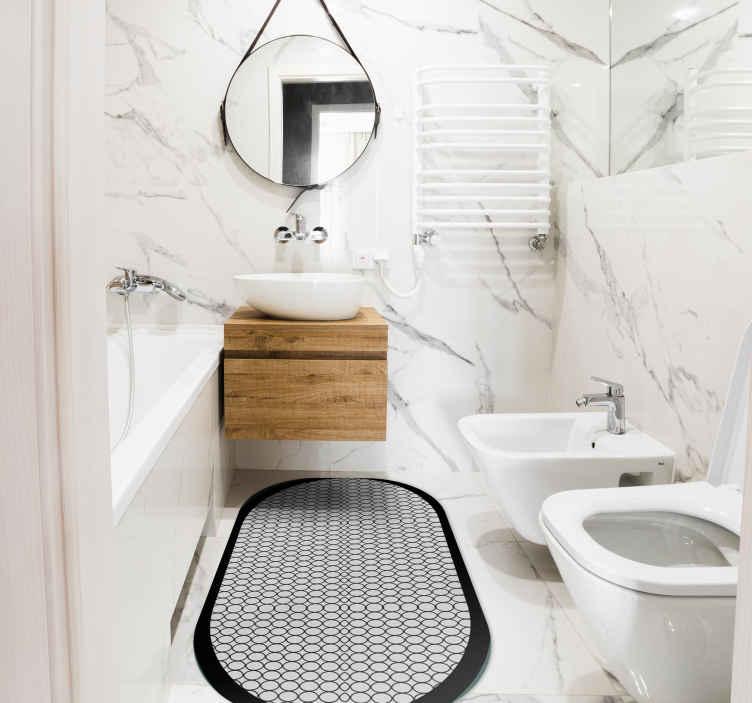 TenVinilo. Alfombra vinilo baño ovalada gris. Alfombra vinilo baño exclusiva para el suelo de tu casa. Decora tu baño con un toque de lujo colocando sobre él este diseño ¡Envío exprés!
