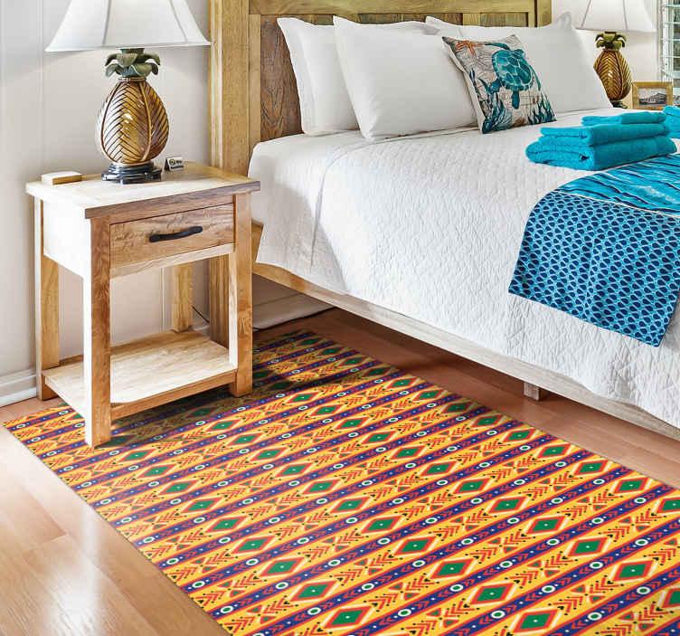 TENSTICKERS. 青、緑、黄色の部族南アフリカエスニックスタイルのラグ. 色とりどりの南アフリカの倫理的なビニールカーペット。カーペットは青、緑、黄色の倫理的な工芸品のパターンでパターン化されています。オリジナルで耐久性があります。