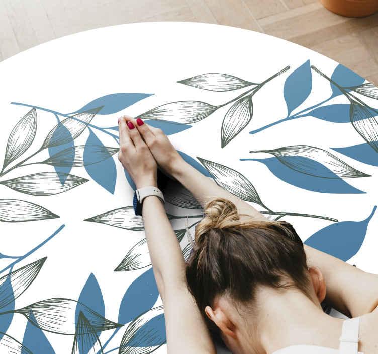 TenVinilo. Alfombra vinilo redonda ramas azules y verdes. Hermosa alfombra vinilo redonda floral para tu hogar con patrón de hojas y ramas que forman un diseño original ¡Envío exprés!