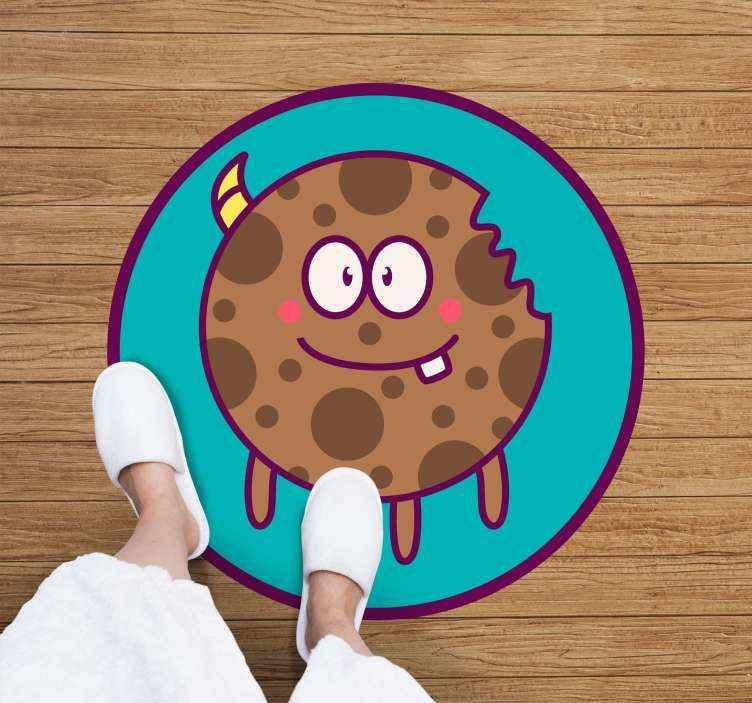 TenVinilo. Alfombra vinilo infantil monstruo galletas. Una colorida alfombra vinílica redonda con el monstruo de las galletas para decorar el suelo de la habitación de tus hijos ¡Envío exprés!