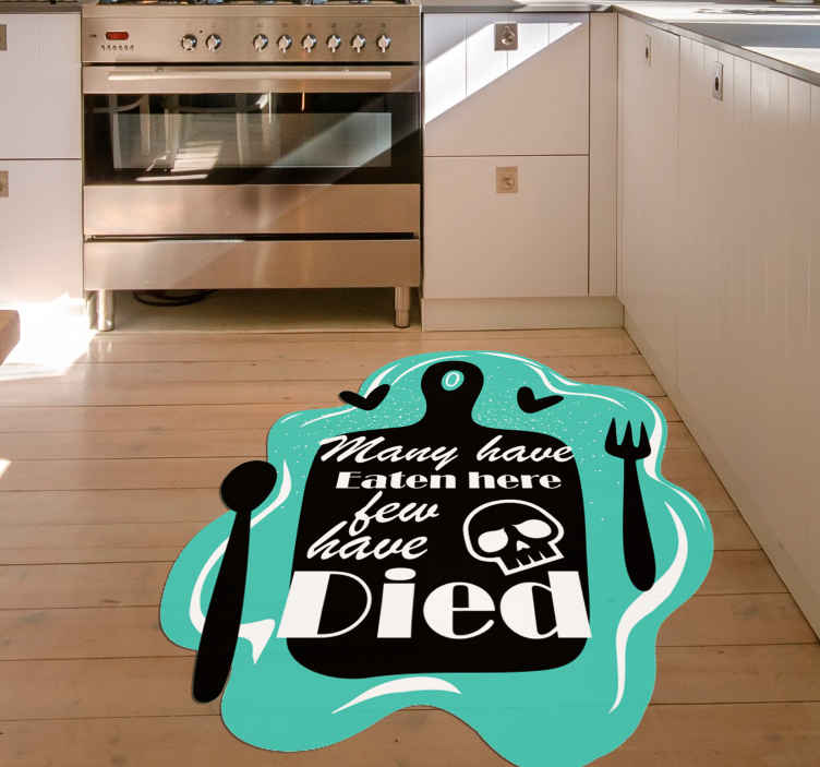 """TenStickers. Funny kitchen quote vinyl carpet. Original cutting board kitchen vinyl rug with the text """"Many have eaten here few have died"""". It has an original wavy shape."""