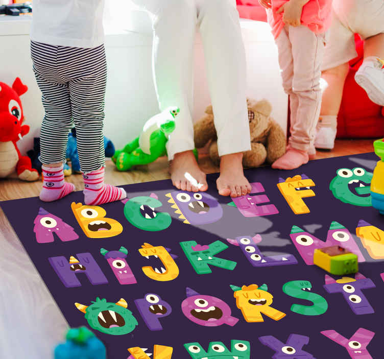 TenStickers. cartoon monster alphabet alphabet rug. Purple vinyl rug with alphabet, perfect as a decorative and educational item for your kids room. Made of high quality vinyl.