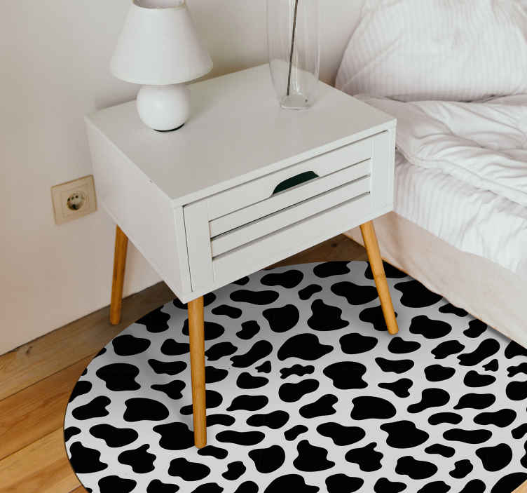 TenStickers. Black cow animal print vinyl carpet. An original black cow animal print vinyl carpet for all the animal print lovers. Decorate your room in a fantastic way with this product!