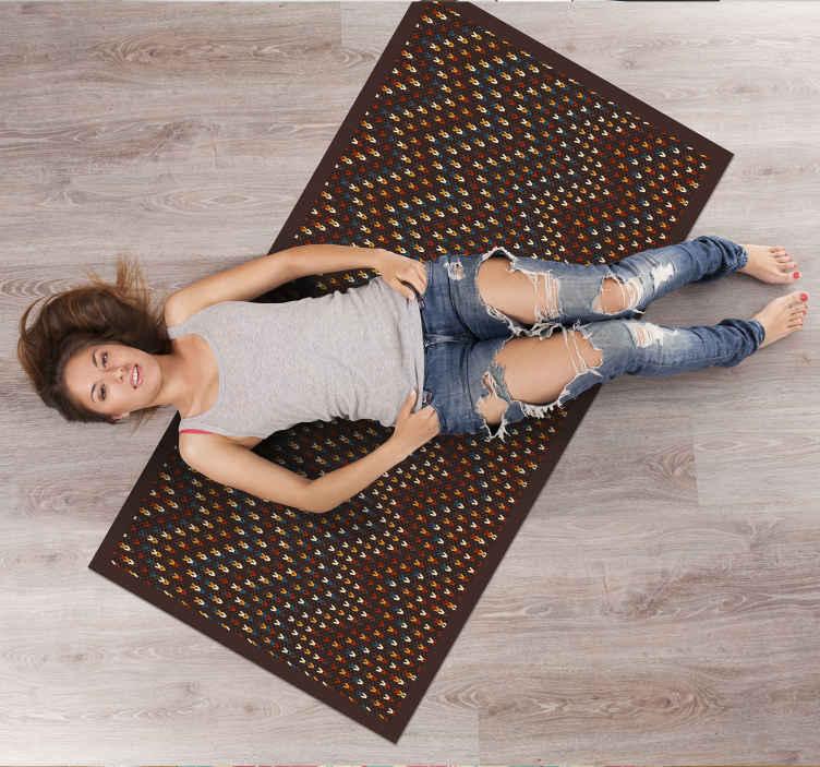TenStickers. Kleurrijke zigzag patroon vinyl tapijt. Wilt u uw huis op een elegante manier opnieuw inrichten met een eenvoudig ontwerp? Dit kleurrijke vinyl tapijt van natuurlijke vezels is gewoon perfect