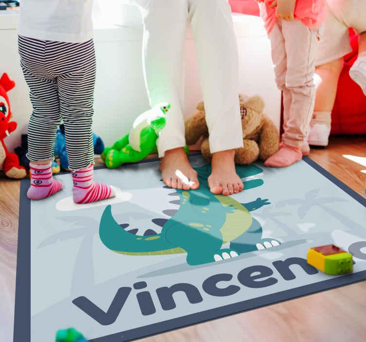 TenVinilo. Alfombra vinilo de T-Rex con nombre . ¡Hazte ya con tu alfombra vinílica infantil con T-Rex con nombre! Diseño con color verde para personalizar ¡Envío exprés!