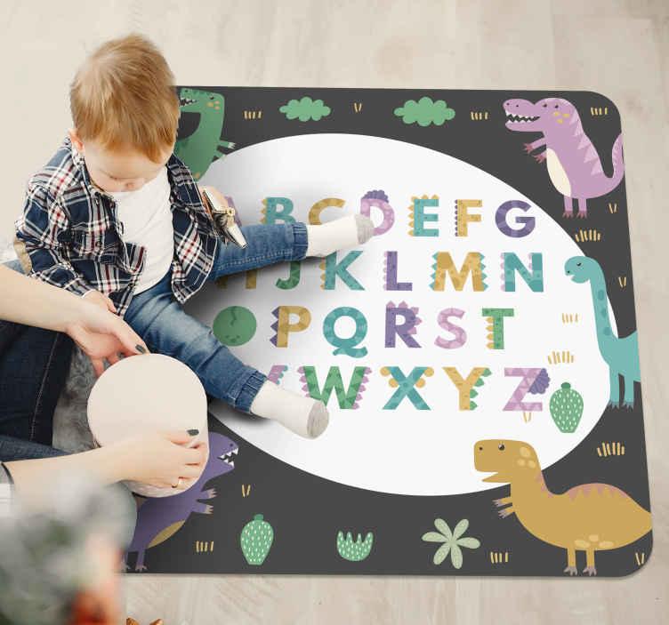 TenVinilo. Alfombra vinilo abecedario con dinosaurios. Maravillosa alfombra vinilo abecedario con letras multicolores y rodeada de dinosaurios. Ideal para cuarto infantil ¡Envío exprés!