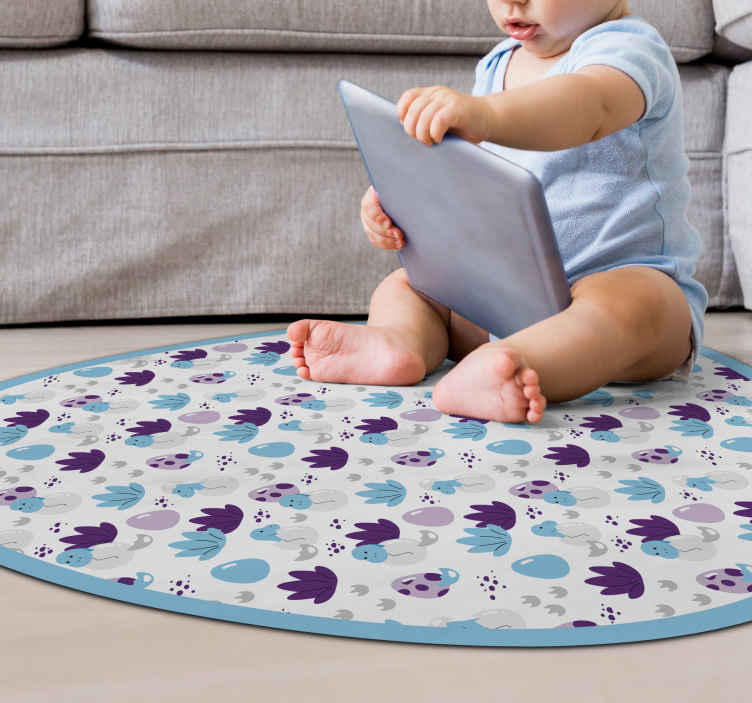 TenStickers. baby dinosaurs coming out from the eggs animal mat. This cute baby vinyl rug with dinosaurs hatching fits perfect for your babys room! It is also very easy to clean! Buy one today!