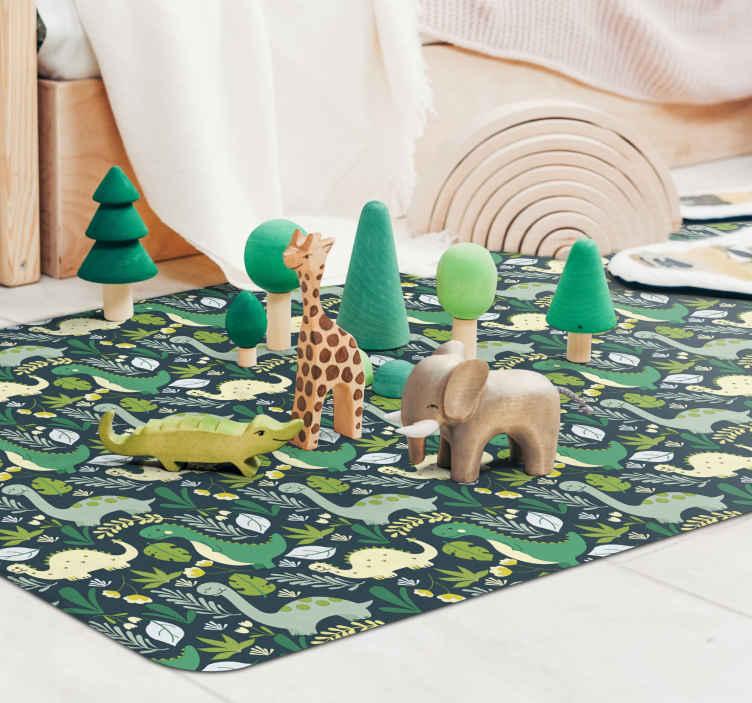 TenVinilo. Alfombra vinilo infantil verde de dinosaurios. Una original y estupenda alfombra vinilo infantil de dinosaurios dibujados a mano sobre fondo natural ¡Descuentos disponibles!
