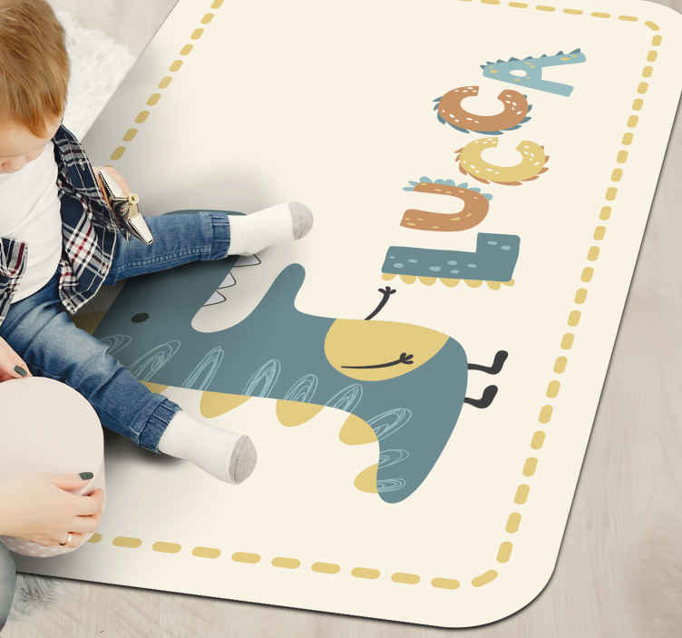 TenStickers. happy dinosaur with personalised name animal mat. Happy dinosaur with personalised name with beautiful dinosaur design in blue domain and white background. Extremely long-lasting material.