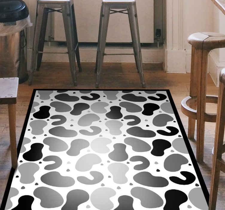 TenStickers. Vinyl tapijt Moderne zwart-witte stippen. Dit moderne vinyl vloerkleed brengt klasse en elegantie in uw huis voor een geweldige nieuwe look. Kies de beste maat voor jou en u huis.
