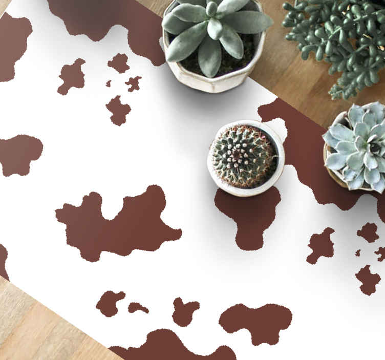 TENSTICKERS. 牛革プリントアニマルプリントビニールラグ. ブラウンとホワイトの素晴らしい牛革プリントパターンが特徴のアニマルプリントビニールラグ。高品質の素材を使用。