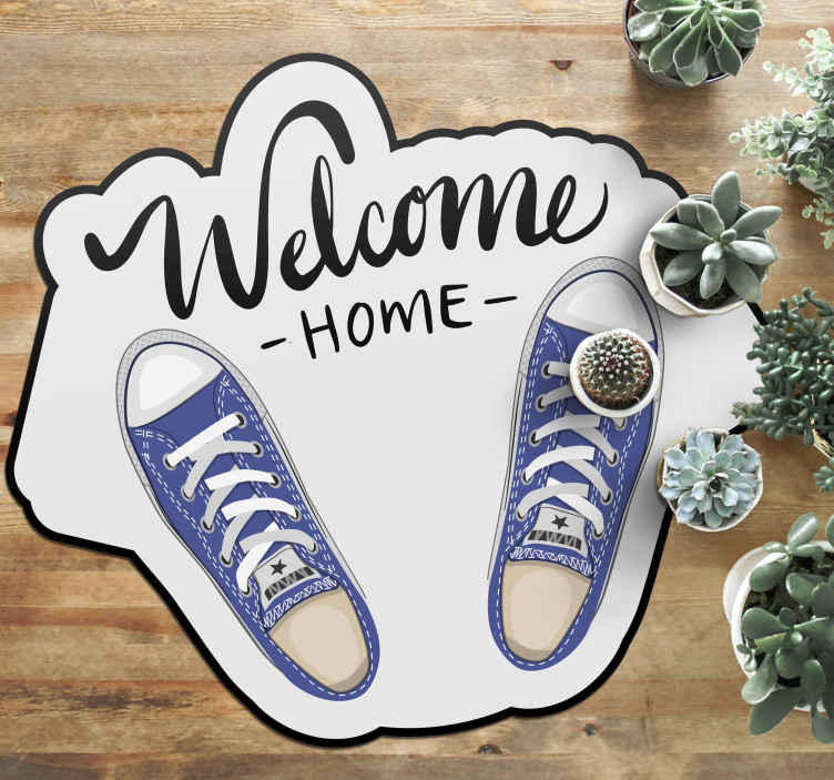 TenStickers. Welcome Home Shoes entrance hall vinyl rug. Entrance vinyl rug which features the text 'Welcome home' next to an image of some converse shoes. Extremely long-lasting material.