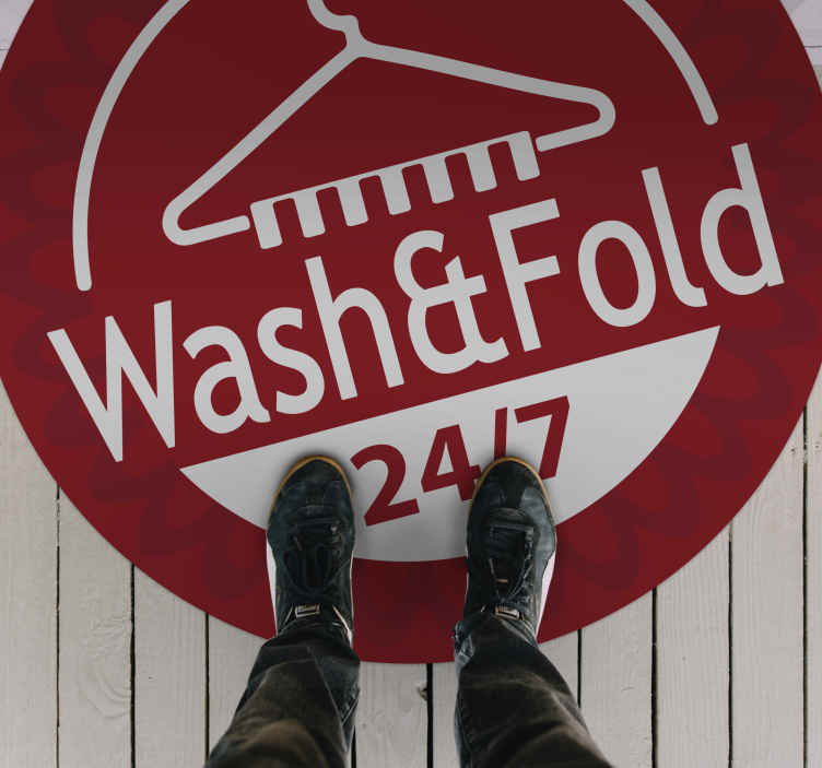 """TenStickers. Laundry 24/7 bespoke rugs. A red circular vinyl rug with a white clothes hook design and the text """"Wash&Fold 24/7"""" perfect for the laundry room or any in your home."""