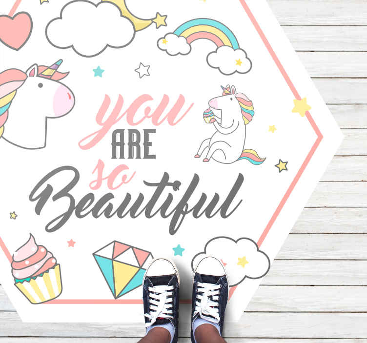 TenStickers. You are so beautiful unicorn vinyl rugs. Unicorn vinyl rug which features the text 'You are so beautiful' surrounded by cartoon unicorns, rainbows, cupcakes, stars, clouds and diamonds.