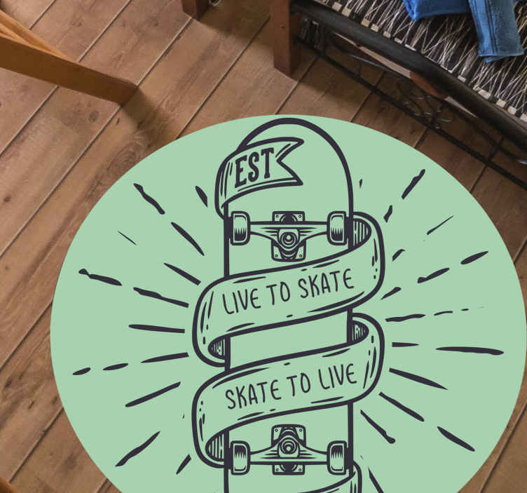 TenStickers. Skate to Live vinyl rugs for bedrooms. Skateboard vinyl rug which features the text 'live to skate, skate to live' wrapped around a skateboard. Extremely long-lasting material.