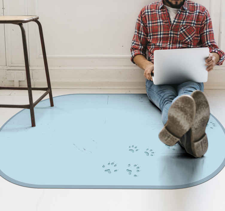 TenStickers. Frozen Pawprint vinyl rugs. Paw print vinyl rug which features an image of frozen permafrost with small paw prints going across it. High quality materials.