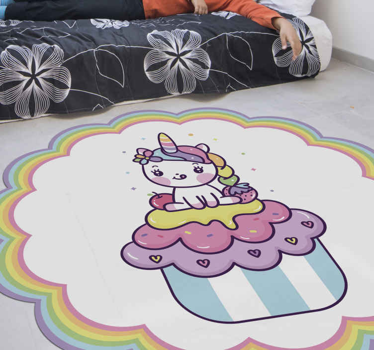 TenStickers. Unicorn sitting on big cupcake smiling kids vinyl carpet. Pretty girl unicorn sitting on big cupcake smiling kids vinyl carpet. A carpet that can be placed on a girl's room and on other space.