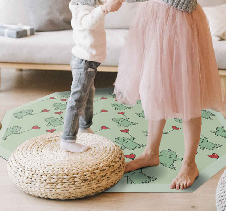 TenStickers. Dinosaur cartoon holding heart balloon kids carpet. Round-tip vinyl carpet with dinosaur holding red heart balloons.  It is really comfortable and safe to play and lay on. Made of quality and durable.
