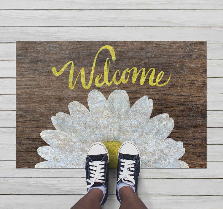 TenStickers. Tapete de boas-vindas com tapete de girassol no hall de entrada. Dê a todos que o visitarem a sensação de que são bem-vindos com este incrível tapete de vinil minimalista! Peça o seu agora!