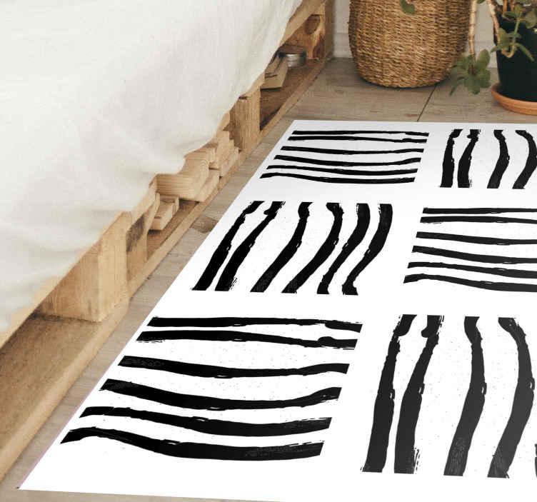 TenStickers. Tapetes geométricos de riscas pretas e brancas. O que você está esperando? Traga um visual artístico para dentro de sua casa e encomende seu tapete geométrico agora mesmo! Com entrega em domicílio!