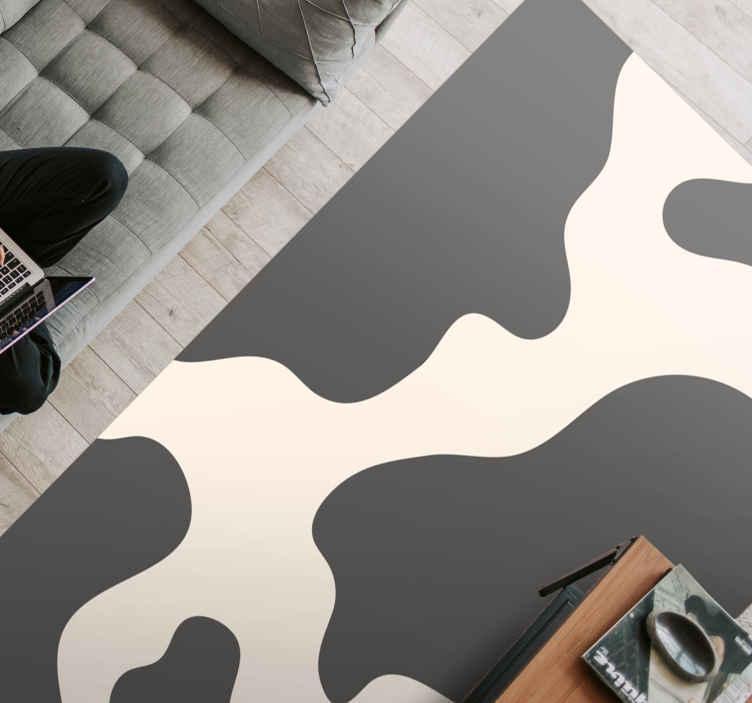 TenVinilo. Alfombra vinilo animal print manchas vaca. Alfombra vinilo animal print con estampado de vaca para decorar tu casa de forma original. Puedes elegir medidas y es fácil de mantener.
