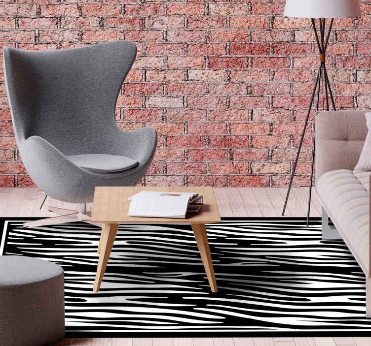 TenVinilo. Alfombra vinilo animal print cebra clásica. Agregue un toque clásico a tu casa con esta original alfombra vinilo animal print de cebra en blanco y negro ¡Descuentos disponibles!