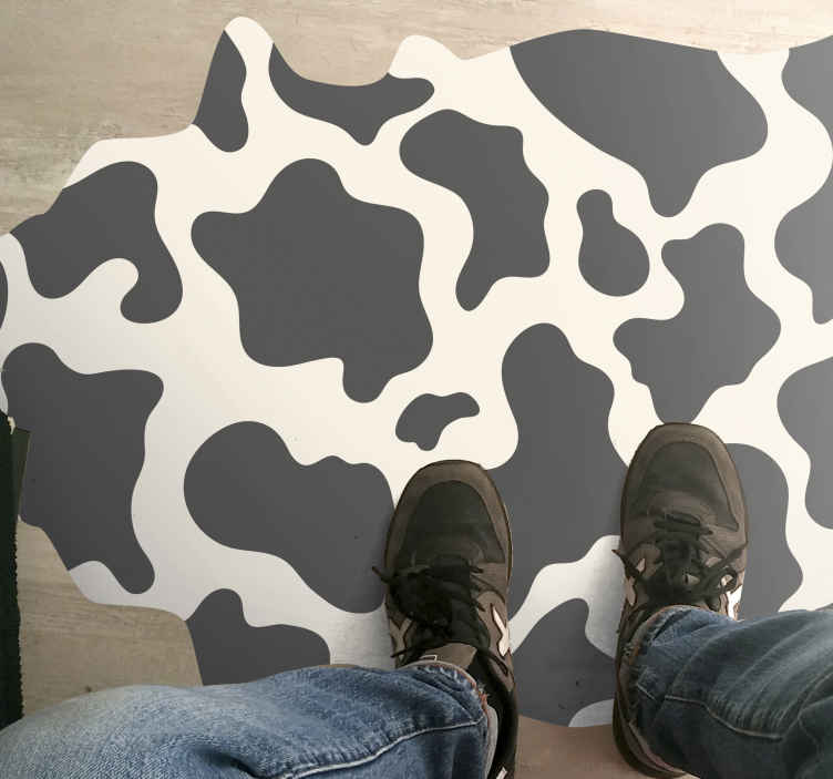 TenStickers. Cow Shape  animal print carpet. This vinyl floor mat with cow pattern is the missing object of your interiorThis animal print  mat can also have a small place in your heart.
