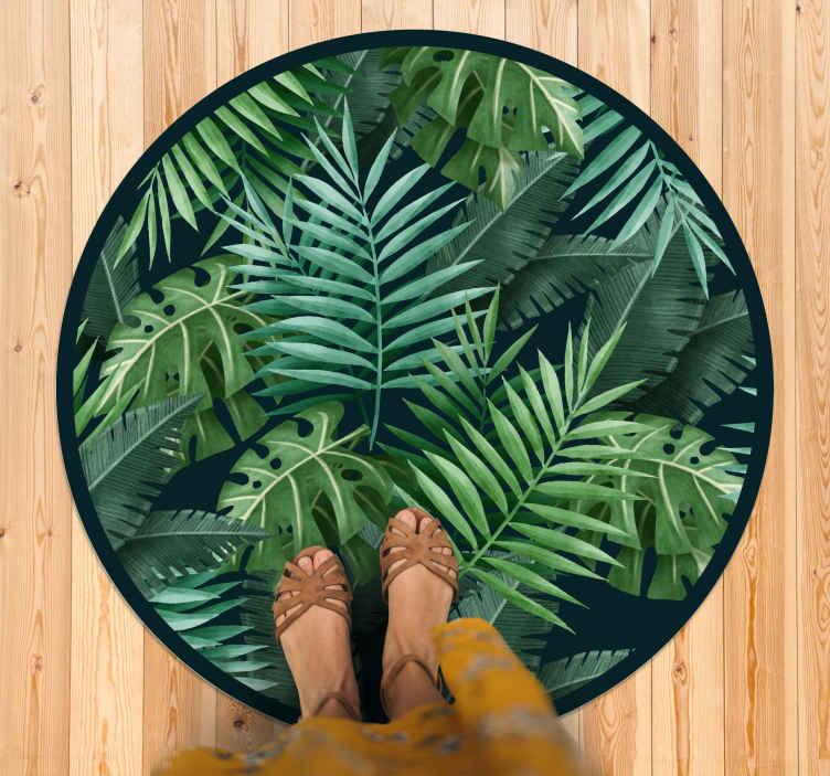 TenVinilo. Alfombra vinilo naturaleza hojas exóticas. Esta alfombra vinilo naturaleza con hermosas hojas de plantas exóticas en diferentes tonos de verde con un marco negro alrededor ¡Envío exprés!