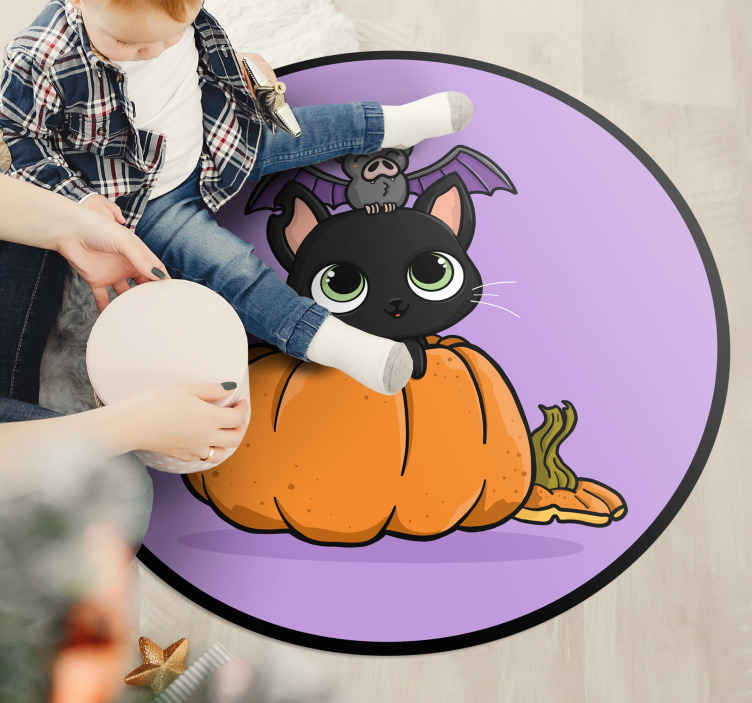 TenStickers. Pumpkin and cat vinyl carpet. Featured pumpkin and cat vinyl rug design. The purple circular vinyl carpet is featured with an orange colour pumpkin and a black cat.