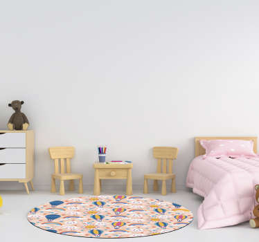 Preciosa alfombra vinílica para habitación de bebé con arcoiris y nubes con la que tu hijo tendrá una decoración alegre. Producto antialérgico