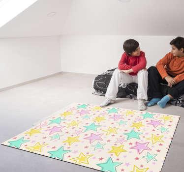 Espectacular alfombra vinílica de estrellas infantil con diferentes colores para decorar habitación de niña. Producto de calidad y antialérgico