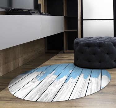 Preciosa alfombra de vinilo textura madera en forma redonda y en color azul y blanca para que decores tu casa con estilo y de forma única.