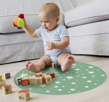 Your child deserves to be able to play on his bedroom floor without risks, so we made him this round vinyl rug of white stars on a green background.