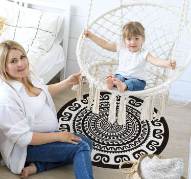 Add an ethnic touch to your decor with this sublime white and black mandala vinyl rug that will look great in any decor.