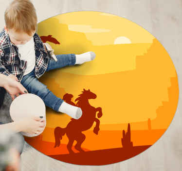 A round-tip vinyl rug with a cowboy riding on a beautiful sun set landscape with desert skyline. The product is made of top quality.