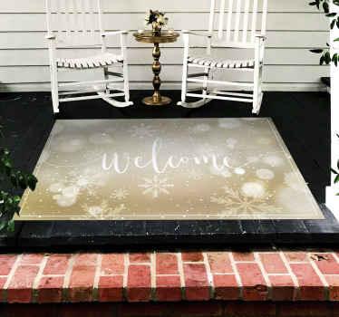 """特色圣诞图案乙烯基地毯设计。合适的入口大厅乙烯基地毯上刻有""""欢迎""""字样,并具有闪亮的雪花效果。"""