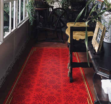 Hallway vinyl rug design to beautify a hall wall in a special and unique way.  This red vinyl carpet is feature with prints of ornamental snow flakes.