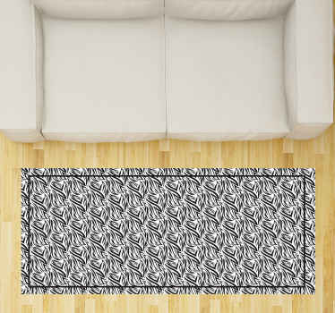 This vinyl rug design features a zebra print pattern printed across it. The rug features a black border. Anti-bubble vinyl.
