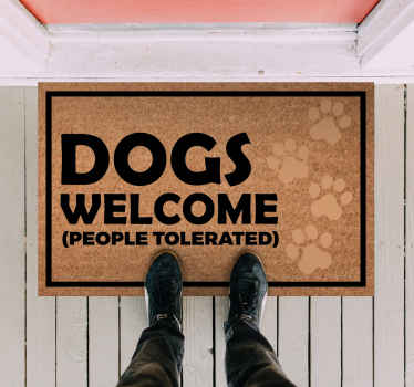 This fantastic vinyl rug design features the text 'Dogs welcome' in a large font. High quality materials are always used.