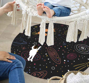 a black background colorful space sketch round vinyl rug to decorate your child's room with a high quality product that gets delivered to your house!