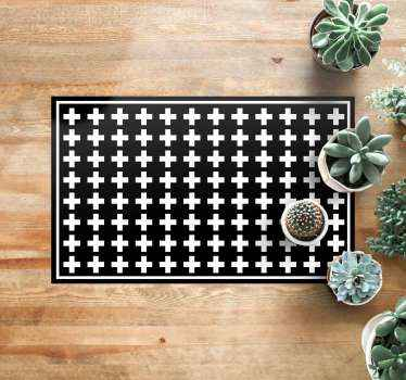 An original but simple black and white crosses vinyl rug to make your house look stunning. High quality product delivered to your house.