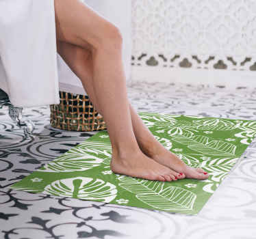 This leaf vinyl rug features a green and white pattern of the Monstera aka Swiss Cheese Plant. Available in lots of different sizes!
