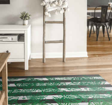 Modern vinyl rug which features a pattern of green monstera plant leaves on a striped black ground. High quality materials.
