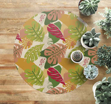 An original round vinyl carpet that can be placed on a living room as center room carpet. It contains colorful design of monstera leaves.