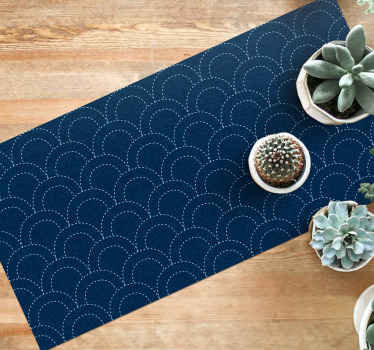 The vinyl rug design features a pattern of white dotted arches on a denim blue background. High quality materials used now.