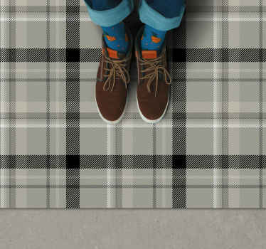 This black and white vinyl rug features a tartan pattern in various shades of grey, black and white. Sign up for 10% off.
