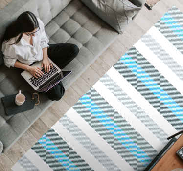 Vinyl rug striped navy blue tones. White and blue stripes design with extra designs within the stripes in diagonal pattern!