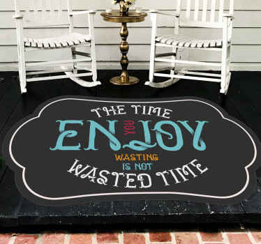 Vinyl carpet with text the time you enkoy wasting is not wasted.  Add the right size, put this item in your shopping cart.
