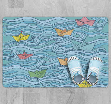 Little paper boats kids vinyl rug suitable for children floor space. The host a design depicting a sea wave with boats sailing on it.