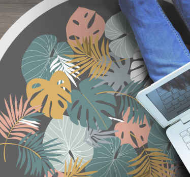 Tropical leaf floral vinyl rug for your home. Change the look of your house with our original round vinyl carpet. Easy to maintain and of quality.